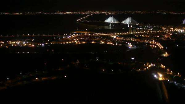 Aerial view of Lisbon, Portugal, at night, taken during an approach to the airport. Royalty-free stock video