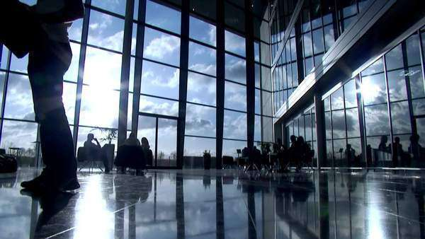 Timelapse with business people silhouetted in modern office building Royalty-free stock video
