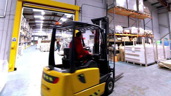 workers and forklift truck driver in a busy warehouse or factory timelapse royalty free - Duties Of A Forklift Operator