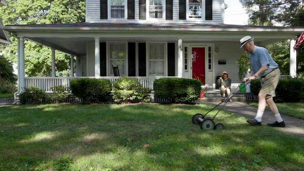 Senior man mowing front lawn Royalty-free stock video