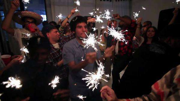 Group of young people dancing with sparklers at party Royalty-free stock video