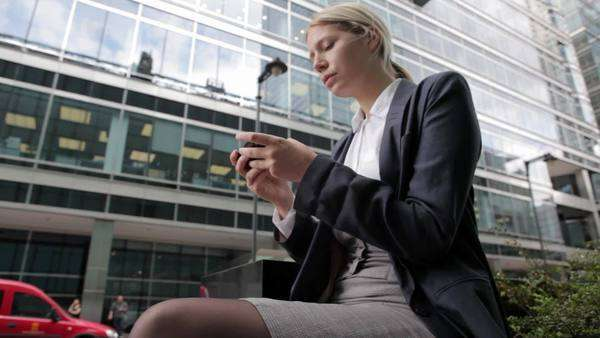 Businesswoman text messaging on cellphone in city Royalty-free stock video