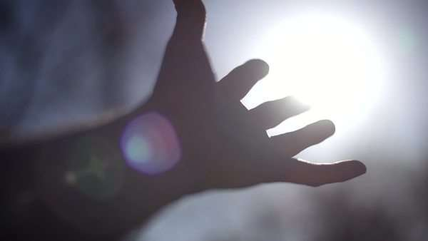 Open hand reaching for the sun Royalty-free stock video