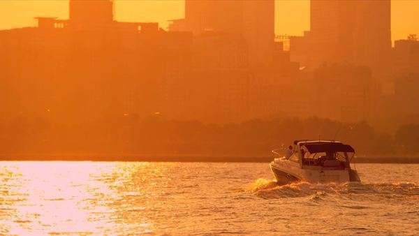 Cabin cruiser on Lake Michigan at sunset Chicago city skyline, Illinois, North America, shot on RED EPIC Royalty-free stock video