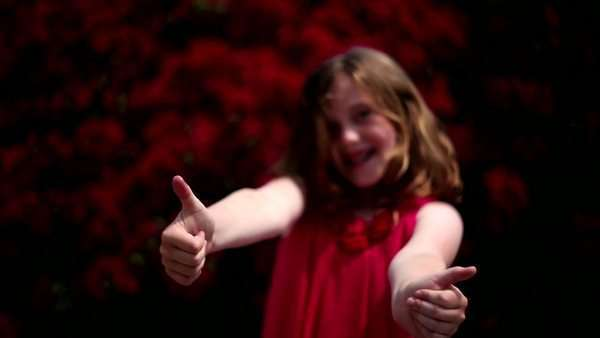 Young redheaded girl making various hand gestures Royalty-free stock video