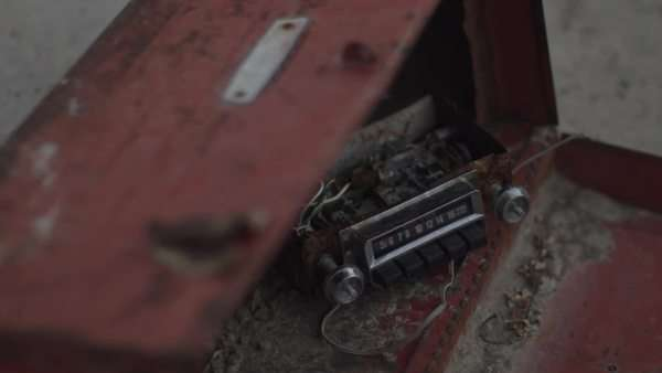 Close up of damaged radio inside rusty metal box Royalty-free stock video