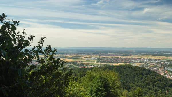 Clouds move over Heidelberg and Mannheim as seen from the Koenigstuhl in Heidelberg. Royalty-free stock video