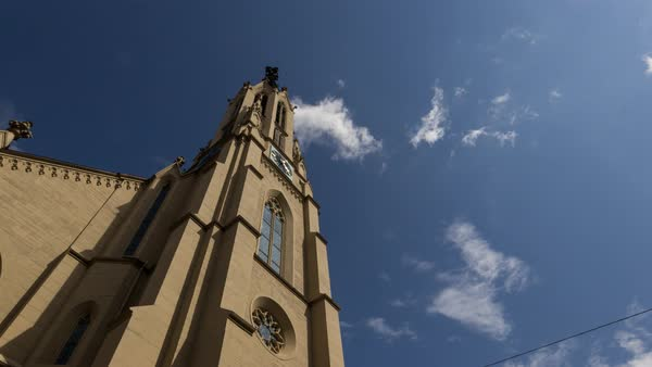 Clouds wizz past a church in Walldorf. Royalty-free stock video