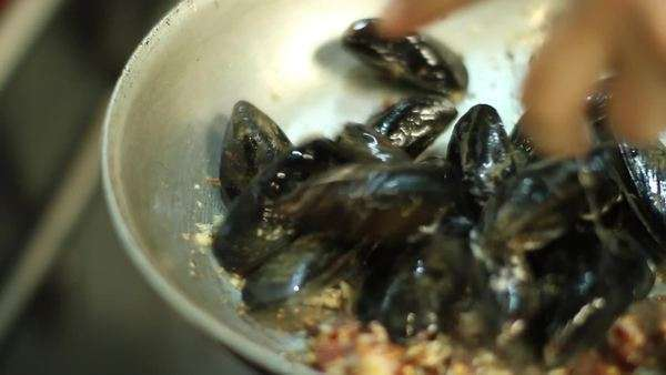 Close-up shot of a cook preparing mussels Royalty-free stock video