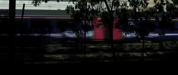 Wide shot of trains through a fence Royalty-free stock video