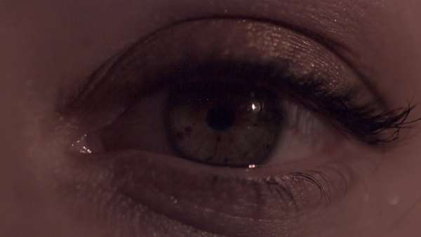 Extreme close-up shot of flashing lights reflecting in a woman's eye Royalty-free stock video