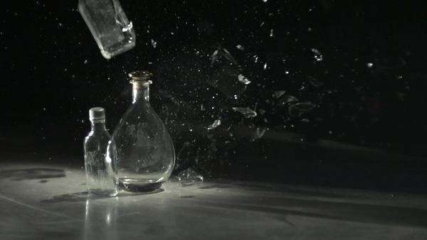 Slow motion shot of a hockey puck crashing into glass bottles Royalty-free stock video
