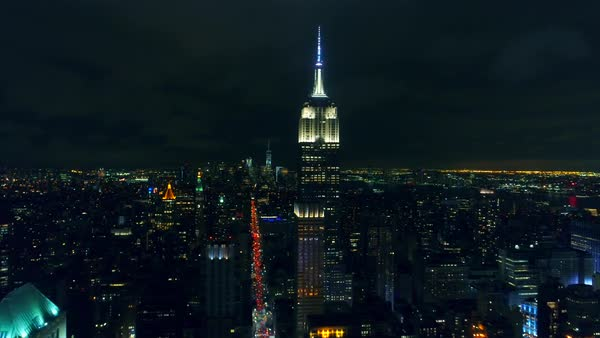 Wide aerial shot of nighttime Manhattan with Empire State Building at the center Royalty-free stock video
