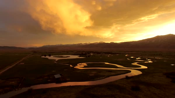 Flying over river at golden sunrise in Wyoming. Royalty-free stock video