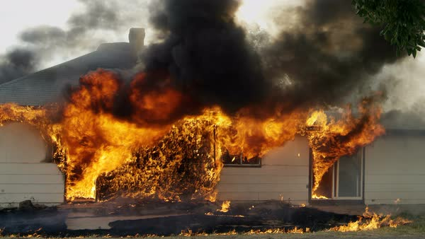 House on fire burning during a controlled burn in Idaho. Royalty-free stock video