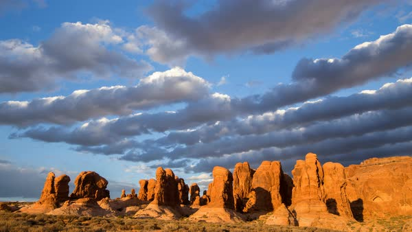 Time lapse of clouds rolling over the Garden of Eden in Arches National Park Utah. Royalty-free stock video