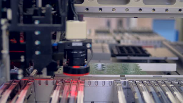 A surface mount technology (SMT) machine making a precise and accurate  installation  Printed circuit board production  stock footage