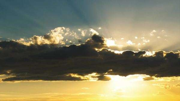Inspiring golden sunset sky timelapse sun shining rays through clouds Royalty-free stock video