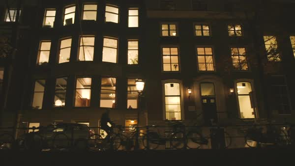Low-angle shot of terraced houses in Amsterdam through a window of a boat Royalty-free stock video