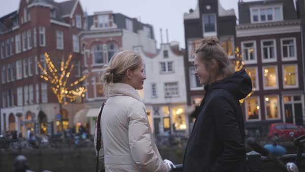 Hand-held shot of two women talking on a street in Amsterdam Royalty-free stock video