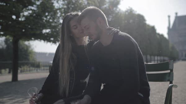 Hand-held shot of a young couple embracing in a park Royalty-free stock video