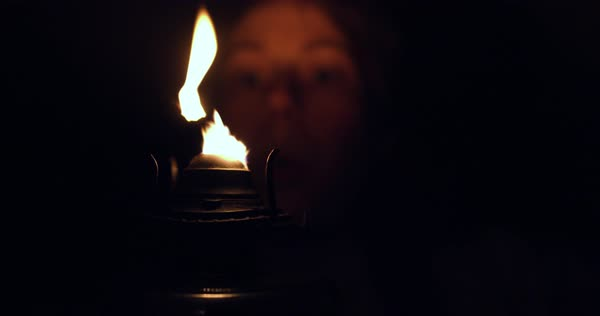 Medium close up shot of a woman blowing out a lantern Royalty-free stock video