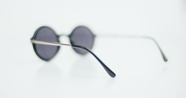 a61dc18f4af3e Stylish round unisex sunglasses isolated on white background - Stock ...