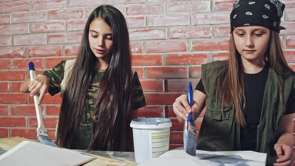 2949760f2 Girl painting wood pieces with paint stock footage