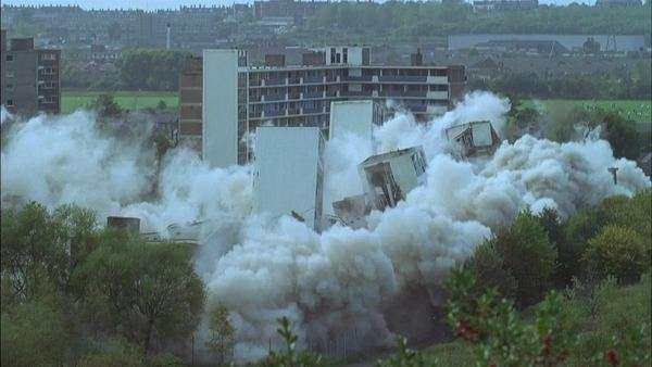 Demolition of an apartment building Rights-managed stock video