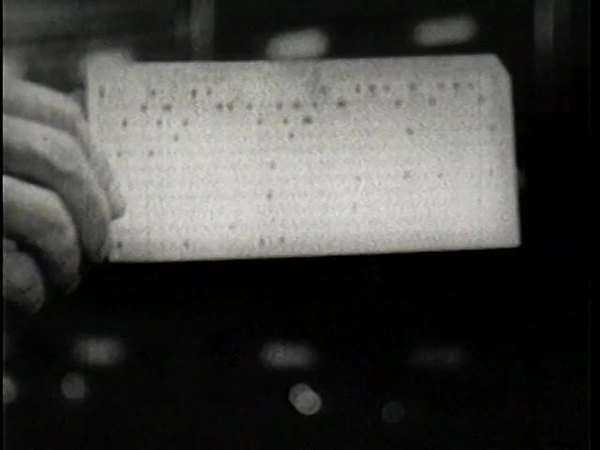 Archival fooage of a punch card pulled from a filing cabinet Rights-managed stock video