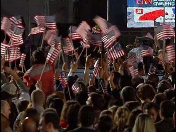 Large crowd waves American flags at election night celebration Rights-managed stock video