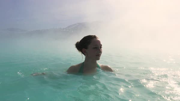 Close-up shot of a woman bathing in a hot spring Royalty-free stock video