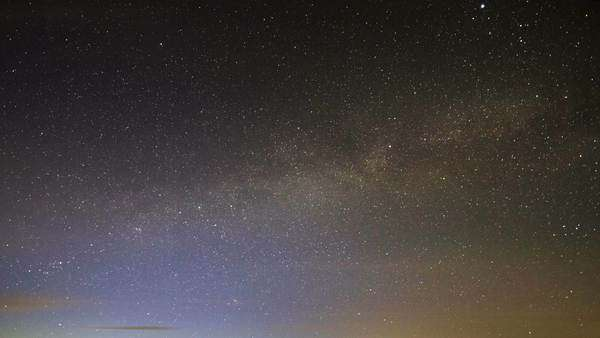Milky Way rotates around the pole star, then dawn Royalty-free stock video