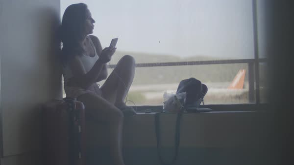Wide shot of a woman using a smartphone Royalty-free stock video