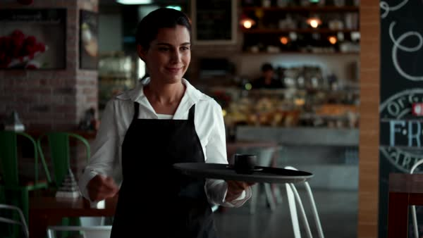 Waitress serving coffee to customer at cafe. Royalty-free stock video
