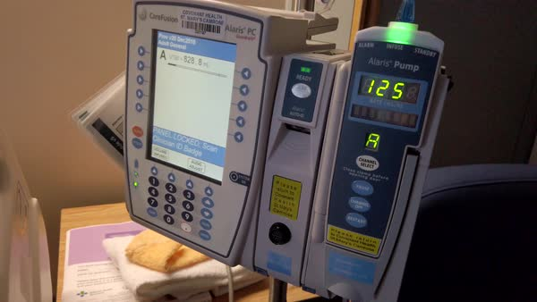 Alaris IV pump and intravenous fluid drip in a hospital stock footage
