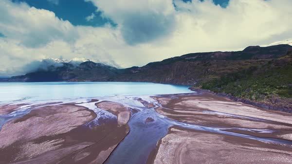 A river of Patagonia flows into a lake view from a drone. Royalty-free stock video