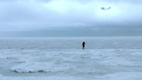 A single figure stands in a barren icy wasteland Royalty-free stock video