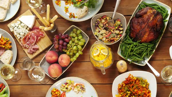 Group Of People Eating At Table With Food Stock Video Footage