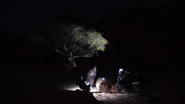 Timelapse of two motorcycle riders camping at night Royalty-free stock video