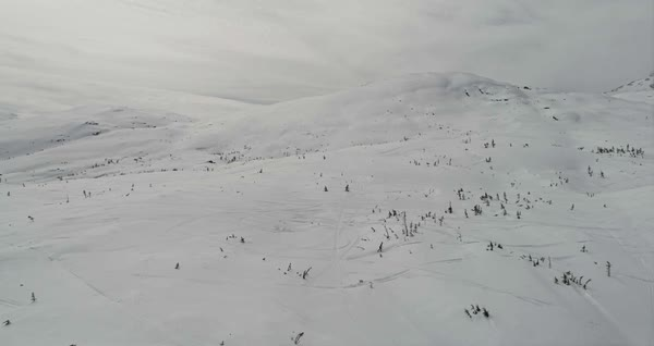 Drone shot view of a person walking on a snowy mountain area Royalty-free stock video