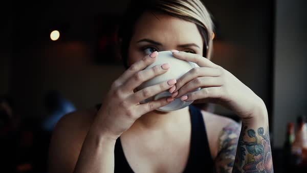 Medium close-up shot of a woman drinking from a cup Royalty-free stock video