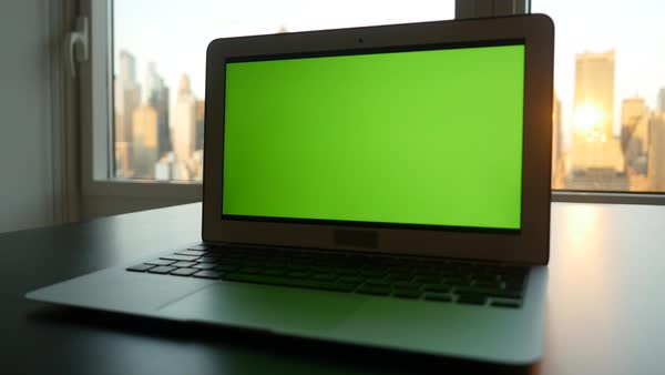 Portable Computer On Office Desk With Green Screen Monitor For
