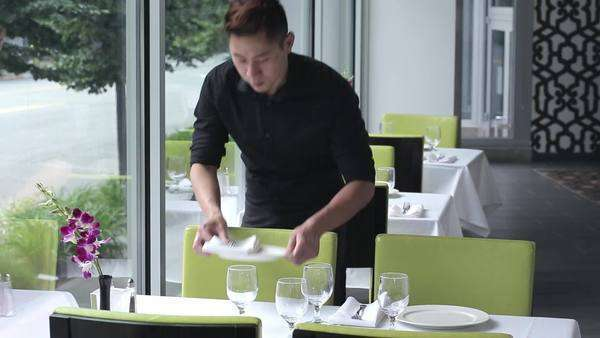 Waiter setting table in restaurant Royalty-free stock video