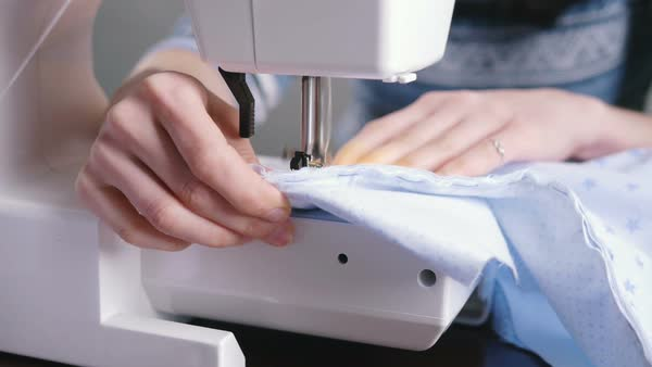 Woman's Hands Working On Sewing Machine Close Up Stock Video Interesting Hands Free Sewing Machine