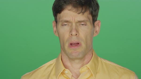 Middle aged man looking sad and tired, on a green screen studio background  Royalty-free stock video