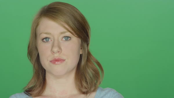 Beautiful brunette woman looking upset, on a green screen studio background  Royalty-free stock video