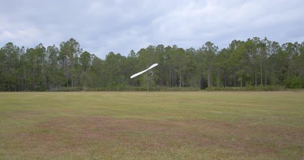Landing Hang Glider in Field, Slow Motion stock footage