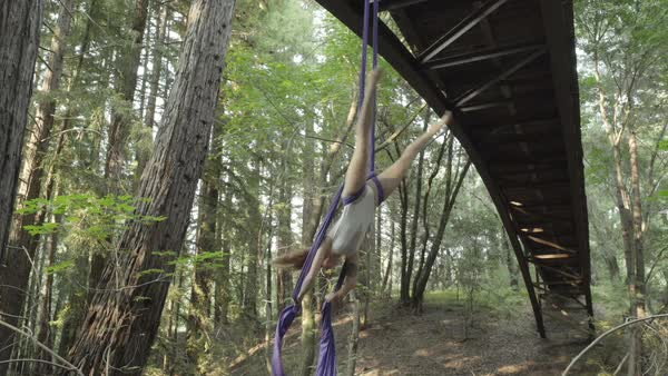 Hand-held shot of a woman performing aerial silk tricks Royalty-free stock video