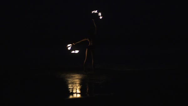 Slow motion shot of a fire dancer performing with fire fans Royalty-free stock video